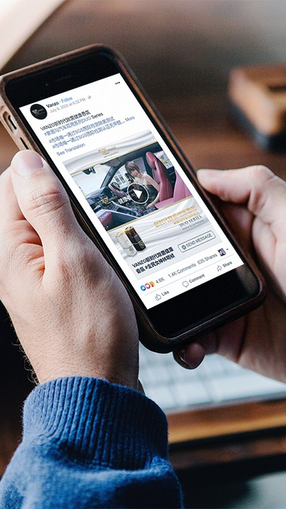 A man viewing an advertisement for Vanzo Asia's car refresher on his iPhone on Facebook.